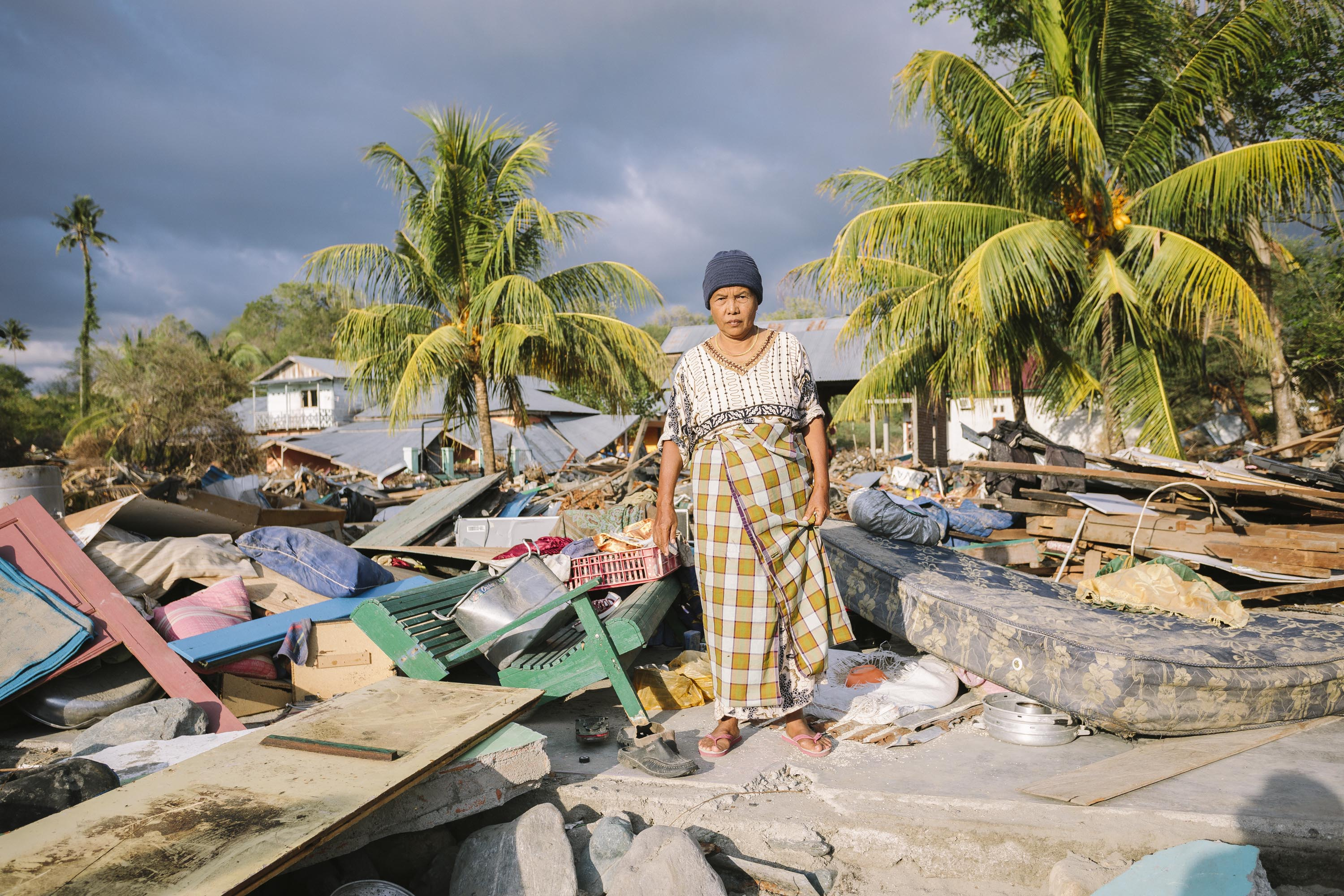 Ernawati, 60, lost everything when the tsunami destroyed her home. She is now living in a small temporary room at her neighbours house. Photo: Benjamin Suomela/Finnish Red Cross